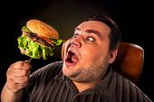Diet failure of fat man eating fast food hamberger. Happy overweight person with wide-open mouth who poster