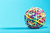 Rubber Band Ball On Blue Background poster