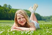 Teenager Girl Lying On Grass
