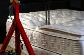 foto of mater  - Mattress testing in mattress factory with copy space - JPG