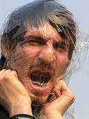 image of scant  - gasp man close  - JPG