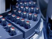 stock photo of hplc  - Capped vials on an analysis autosampler  - JPG
