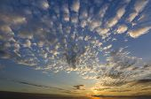 Panorama Of Sky At Sunrise Or Sunset. Beautiful View Of Dark Blue Clouds Lit By Bright Orange Yellow poster
