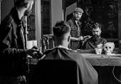 Barber Preparing Hair Clipper For Bearded Man, Barbershop Background. Hipster Lifestyle Concept. Hip poster