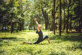 Anjaneyasana. Yoga Asanas In Nature. Yoga Poses Everyday. Practicing Young Woman. Yoga In The Park poster