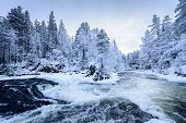 The River In Winter Season At Oulanka National Park, Finland. poster