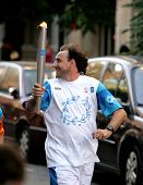 BARCELONA - JUNE 28: Spanish athlete Fermin Cacho carries the Athens 2004 Olympic torch during the B