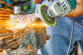 Close Up Hand And Electric Wheel Grinding On Steel Structure In Factory,sparks From The Grinding Whe poster