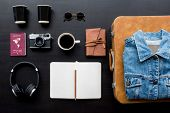 Flatlay of gadgets on black background poster