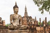 Buddha Statues At Wat Mahathat Ancient Capital Of Sukhothai, Thailand. Sukhothai Historical Park Is  poster