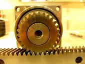 image of gear-shifter  - Certainty and persuasion in gold gear - JPG