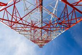 Bottom View Of A Telecommunications Tower. Red And White Cell Phone Tower Against Blue Sky, Bottom V poster