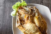 deep fried sea bass with fish sauce and spicy salad poster