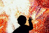 Child Touch The Big Screen. Child Hand Touches On The Colored Glass poster