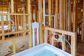 Interior Wall Framing With Piping And Bathroom Installed Plumbing Pipes And Exposed Beams. poster