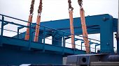 Crane Lifts Heavy Iron Detail. Clip. Industrial Iron Large Metal Gantry Crane With A Hook Mounted On poster