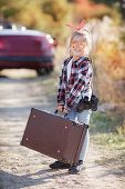 Cute Little Girl Traveling Alone On A Rural Road On A Red Cabriolet.travel Concept.cute Little Girl  poster