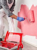 Professional House Painter At Work Painting The Wall poster