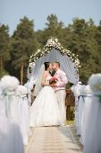 picture of solemn  - happy newly married couple on solemnization of marriage outdoor - JPG