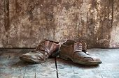 image of hillbilly  - Old dirty brown leather shoes on wooden floor - JPG