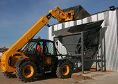 stock photo of jcb  - tipper dropping gravel stones at industrial quarry works - JPG