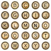 foto of outdated  - Alphabet made of Antique typewriter keys on white - JPG