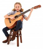 stock photo of ten years old  - Beautiful ten year old with acoustic guitar over white with clipping path - JPG