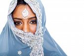 stock photo of sari  - traditional Indian woman in sari covering her face with veil - JPG