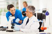 foto of chemistry technician  - group of lab technicians working in laboratory - JPG
