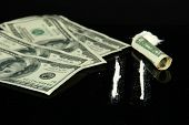 stock photo of crack cocaine  - Cocaine drugs heap and lines on  mirror with rolled banknote - JPG