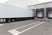 stock photo of semi trailer  - White box semi trailer at warehouse loading bay - JPG