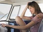 stock photo of campervan  - Happy young woman sitting in driver - JPG
