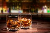 stock photo of whiskey  - Whiskey drinks on wood - JPG