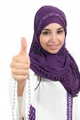 stock photo of hijabs  - Beautiful and happy arabian woman wearing a hijab with thumb up isolated on a white background - JPG
