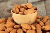 picture of piles  - Almond in wooden bowl - JPG