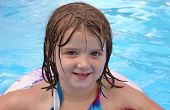 stock photo of floaties  - An adorable five year old girl enjoys some recreational time in the pool - JPG