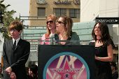 Rodney Bingenheimer and Debbie Peterson with Vicki Peterson and Suzanna Hoffs at the Hollywood Walk