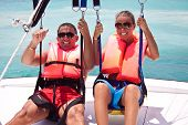 foto of parasailing  - Happy couple Parasailing in Dominicana beach in summer - JPG