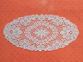 pic of crotch  - white mat crotch doilie isolated over red background - JPG