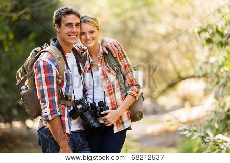 happy young couple hiking in mountain poster