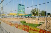 picture of truck-stop  - iron fence with red yellow security tape stop the construction site in the city - JPG