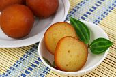 image of gulab  - Gulab jamun dessert in bowl on bamboo mat - JPG