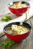 stock photo of duck breast  - Miso soup with duck breast in red cups - JPG