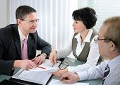stock photo of business meetings  - Senior couple meeting with agent in a office - JPG