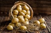 stock photo of carbohydrate  - Raw yellow new potato in a basket - JPG
