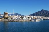 stock photo of sea-scape  - Harbour entrance with the watchtower to the left and La Concha mountain to the rear Puerto Banus Marbella Costa del Sol Malaga Province Andalucia Spain Western Europe - JPG