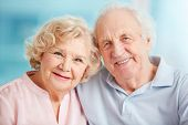 stock photo of sweethearts  - Portrait of a candid senior couple enjoying their retirement - JPG