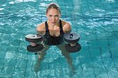 pic of day care center  - Fit blonde working out with foam dumbbells in swimming pool at the leisure centre - JPG