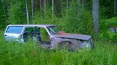 image of derelict  - Old derelict car lost in the woods - JPG
