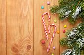 image of view from space needle  - Christmas wooden background with snow fir tree and candies - JPG
